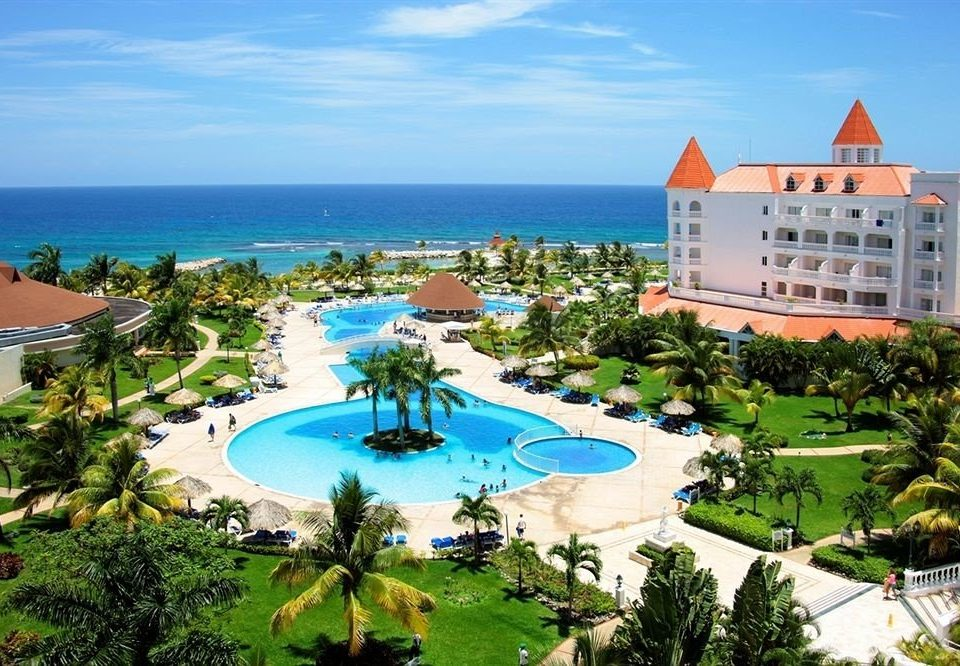 All-inclusive Beachfront Grounds Pool Resort Tropical sky leisure property Nature caribbean resort town swimming pool lawn Villa shore