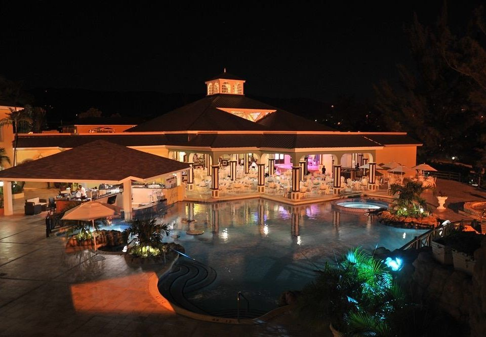 All-inclusive Beachfront Grounds Pool Resort Tropical night evening lighting restaurant