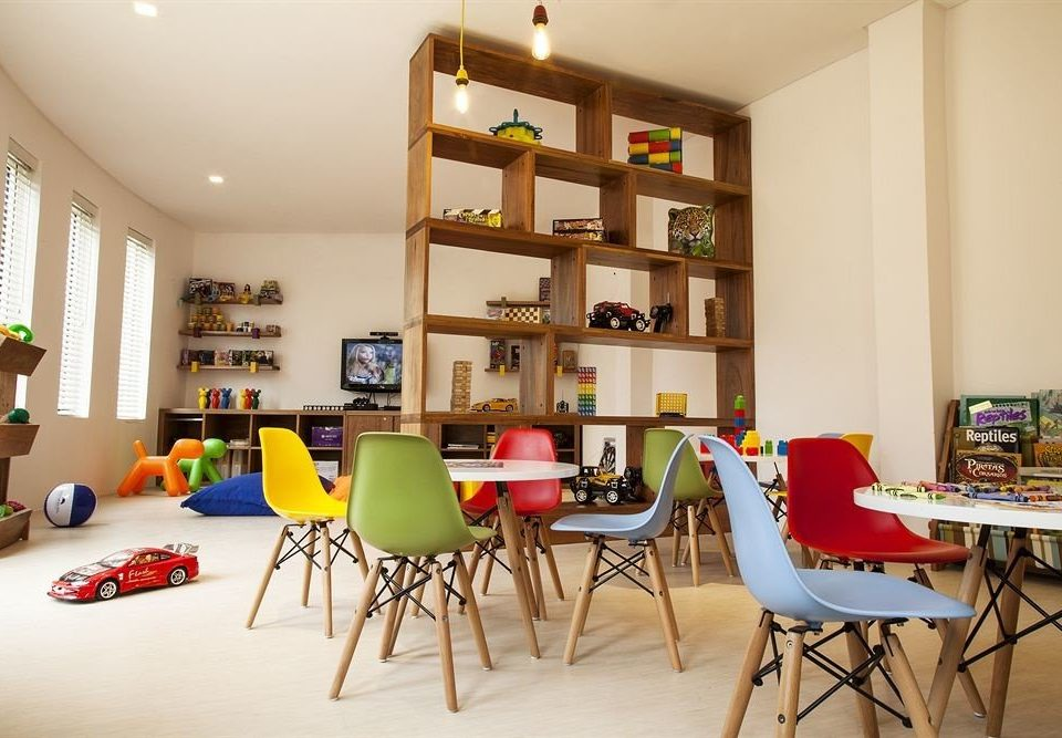 All-inclusive Beachfront Kids Club Modern Waterfront property chair home living room