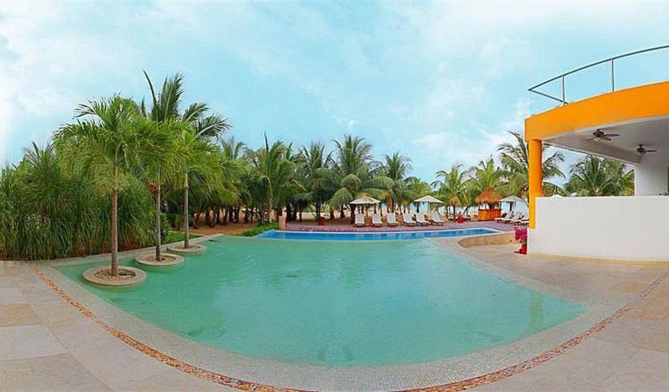 All-inclusive Beachfront Lounge Modern Pool Waterfront sky tree swimming pool leisure property Resort Water park caribbean Villa resort town hacienda condominium Lagoon palm