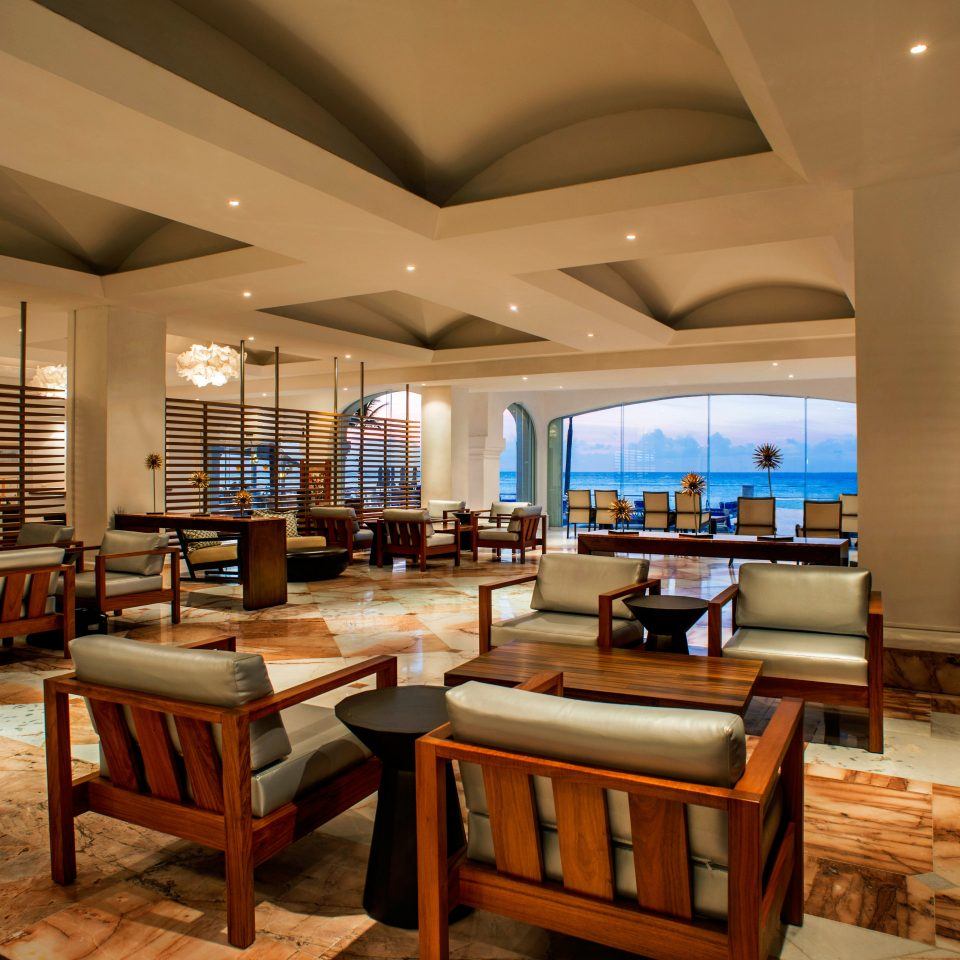 All-inclusive Beachfront Lounge Luxury Scenic views chair Lobby Resort restaurant living room convention center