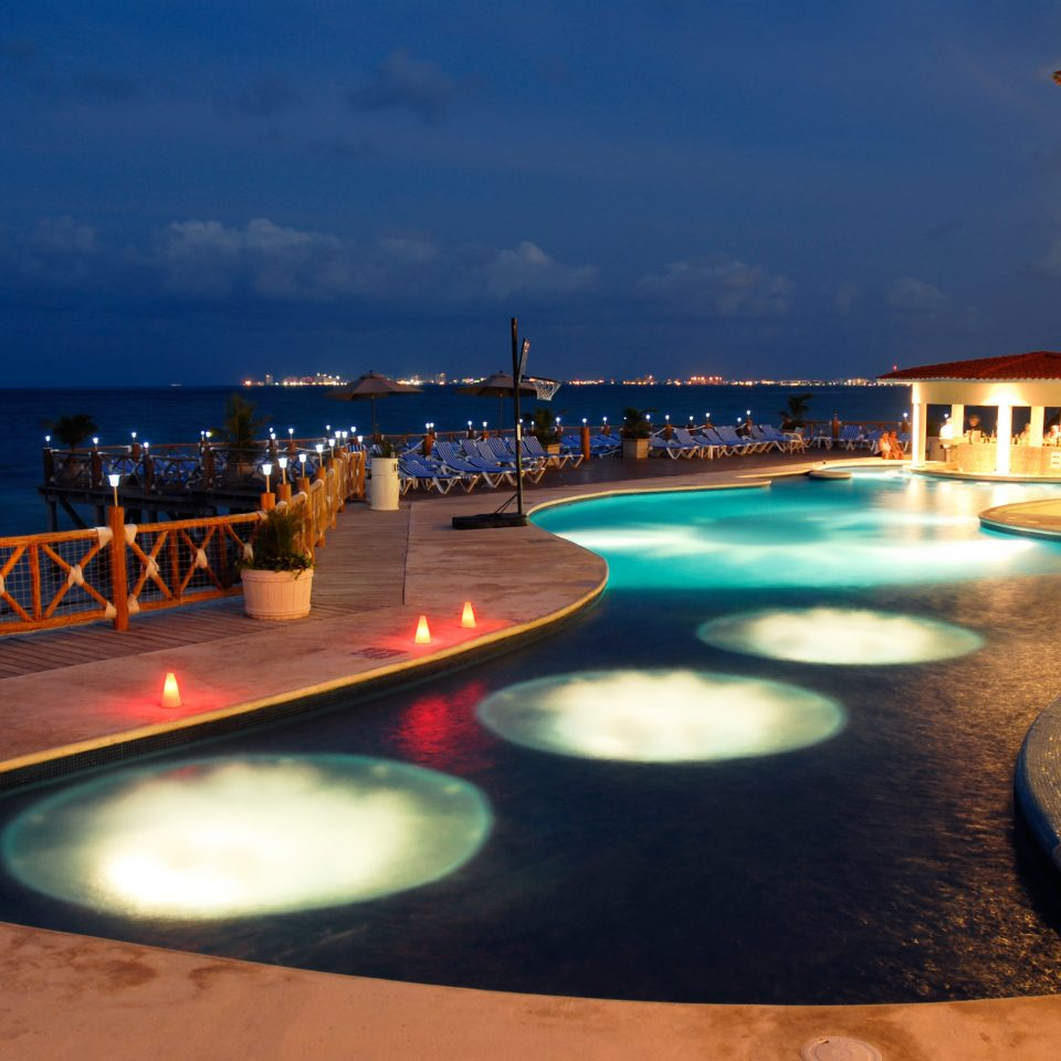 All-inclusive Beachfront Luxury Pool Resort sky water swimming pool night Sea evening Ocean dusk