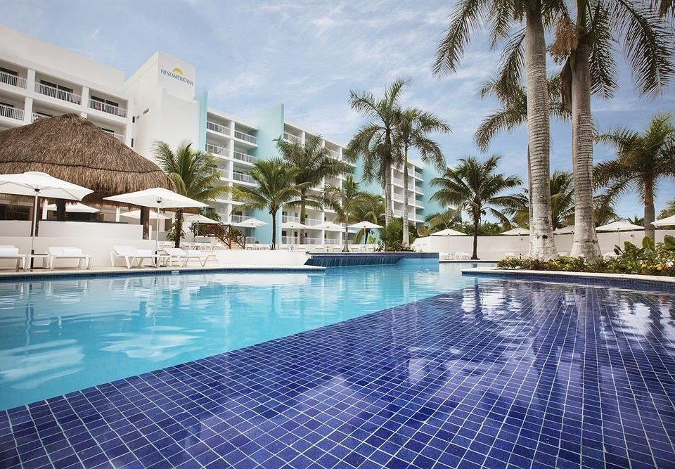 All-inclusive Beachfront Modern Pool Waterfront swimming pool property leisure Resort condominium reflecting pool blue resort town Villa backyard mansion day