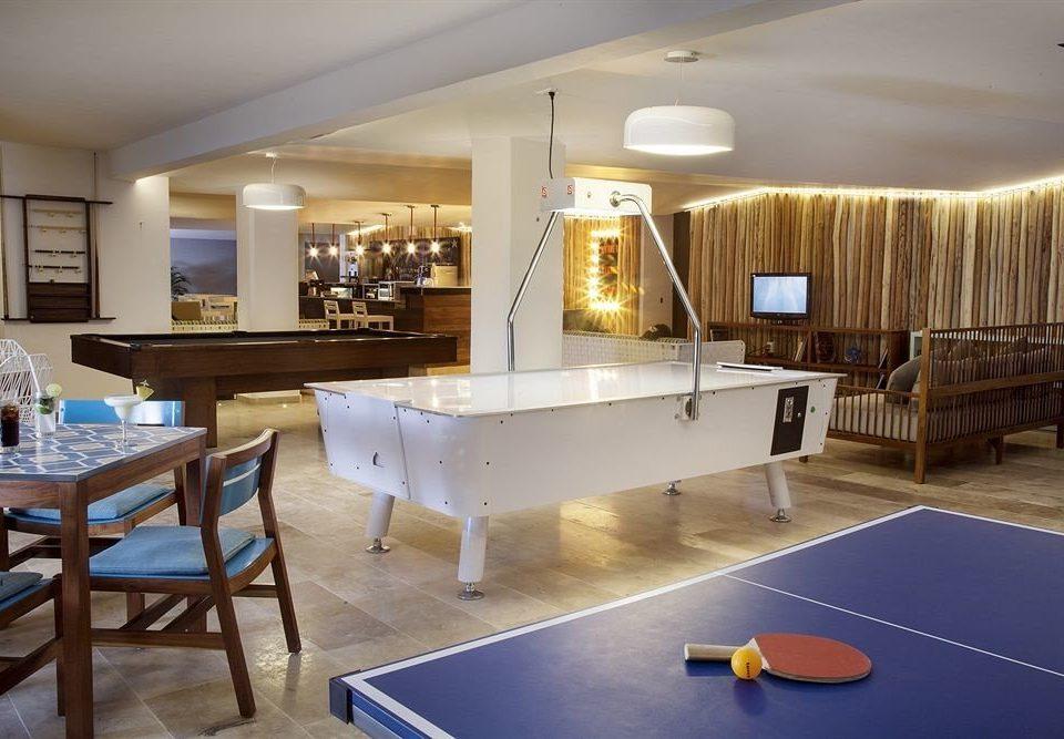 All-inclusive Beachfront Modern Waterfront recreation room property chair billiard room living room home flooring condominium