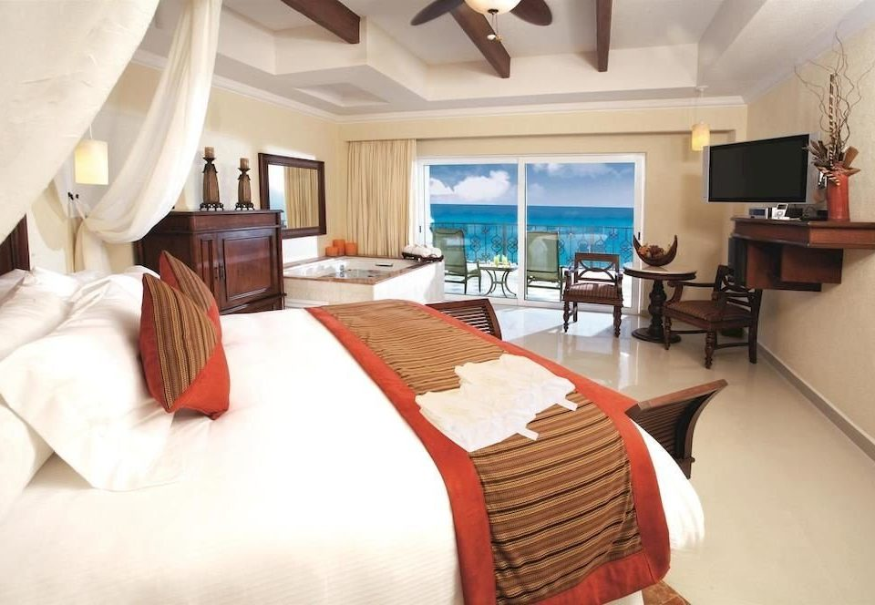 All-inclusive Bedroom Modern Ocean Scenic views Waterfront sofa property Suite cottage white Resort Villa