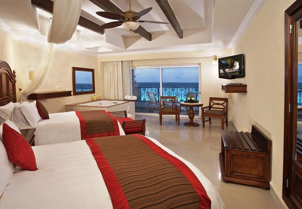 All-inclusive Bedroom Modern Waterfront property Suite Resort cottage home living room Villa