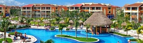 All-inclusive Buildings Exterior Grounds Pool Resort building water sky house leisure property Boat blue Water park resort town amusement park swimming pool Village eco hotel docked swimming surrounded