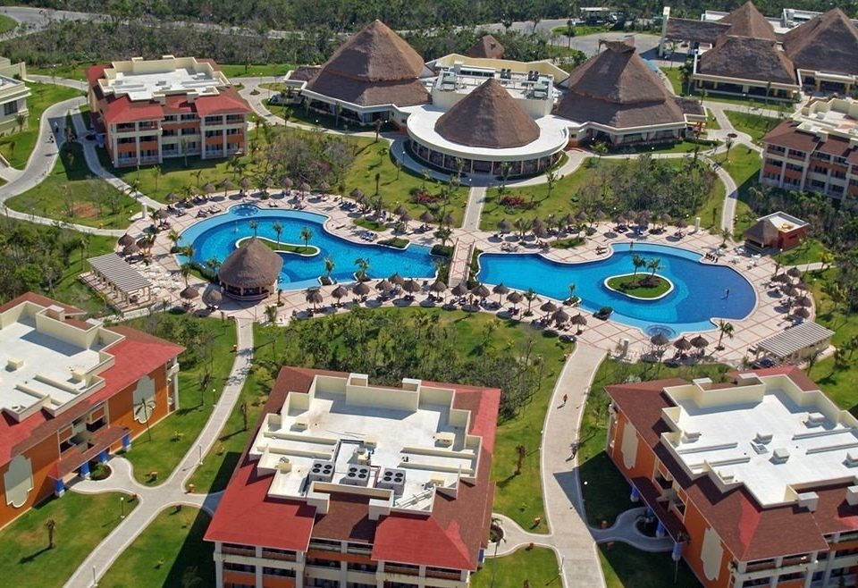All-inclusive Budget Exterior Family Pool Resort Tropical Waterfront grass amusement park leisure property lawn Town park residential area Water park neighbourhood outdoor recreation bird's eye view recreation aerial photography set