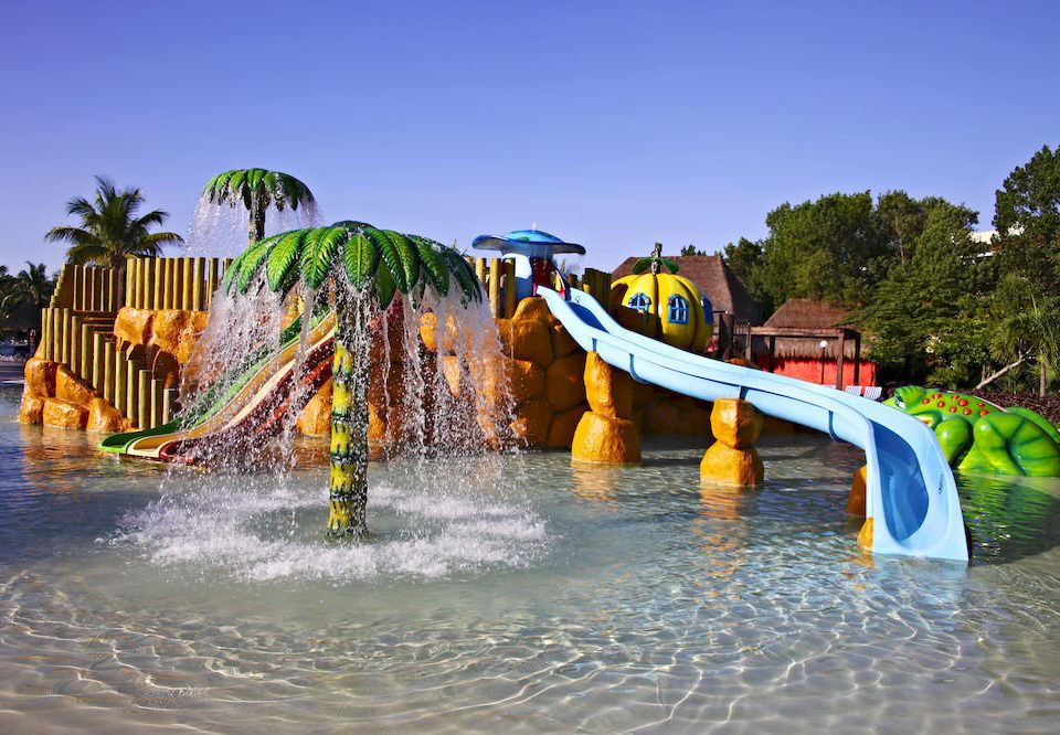 All-inclusive Budget Exterior Family Pool Resort Tropical Waterfront leisure yellow amusement park Water park park outdoor recreation recreation nonbuilding structure
