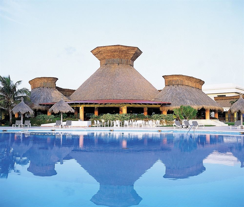 All-inclusive Budget Family Pool Resort Tropical Waterfront sky water swimming pool Lake palace old surrounded