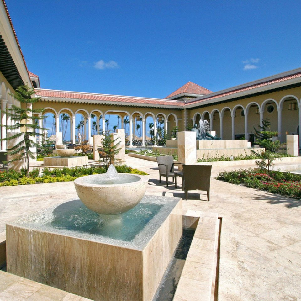 All-inclusive Family Grounds Luxury Resort Romantic sky building property Villa hacienda Courtyard mansion home palace stone porch swimming pool colonnade walkway court