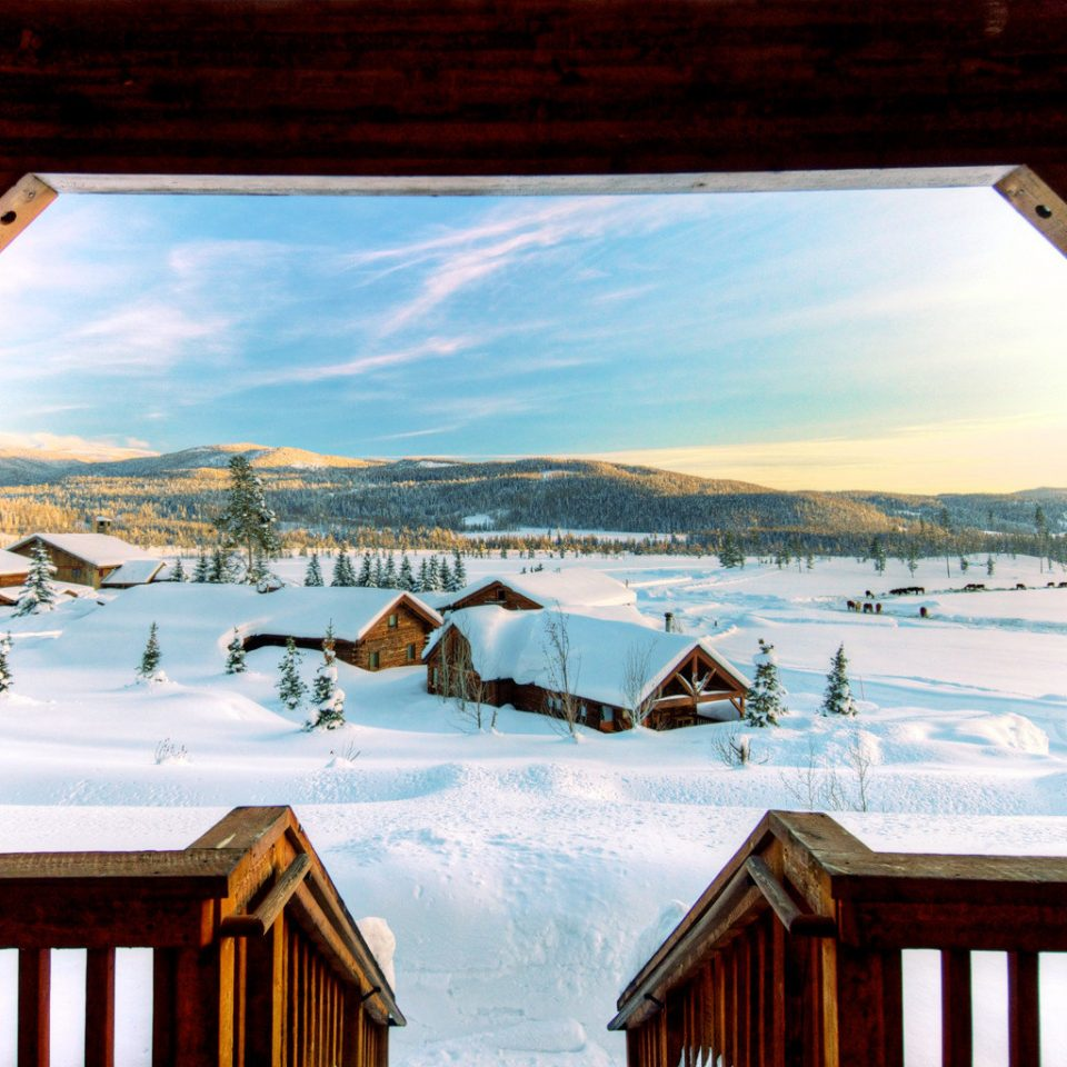 All-inclusive Lodge Mountains Outdoor Activities Outdoors Ranch Romantic Scenic views building house home season Winter Resort snow cottage overlooking Deck