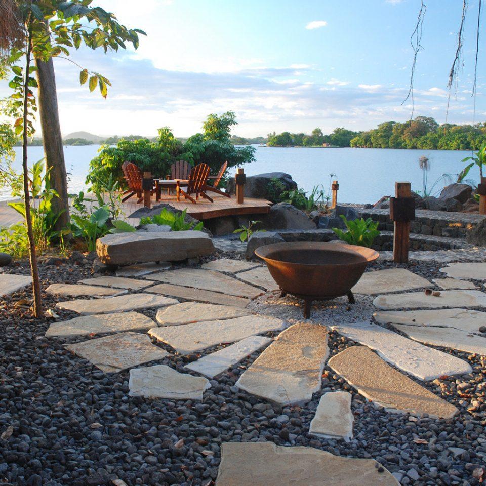 All-inclusive Eco Grounds Resort Romance Romantic Trip Ideas Wellness sky ground property walkway backyard yard swimming pool home Patio landscaping Garden plant sandy stone