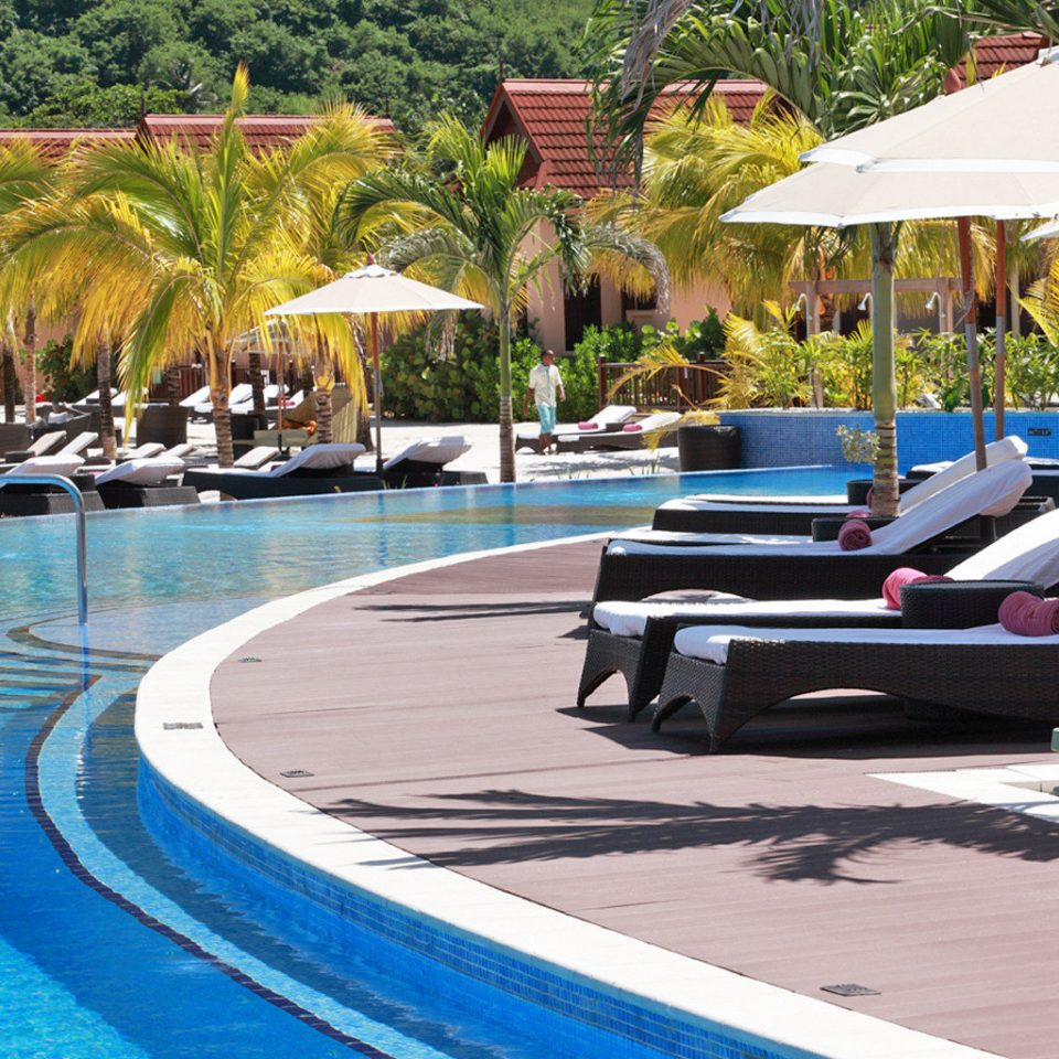 All-inclusive Family Lounge Patio Pool Resort Tropical tree leisure swimming pool chair dock Water park walkway marina Villa lined day