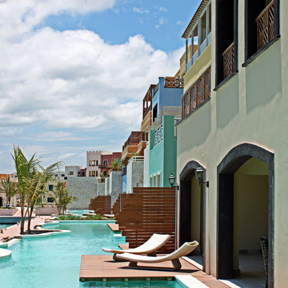 All-inclusive Family Pool Resort Romance Romantic Waterfront sky property house home swimming pool condominium