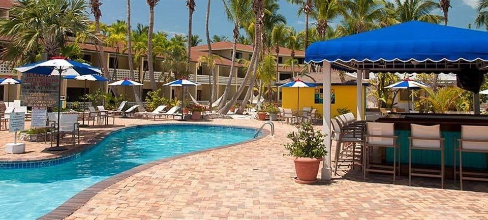 All-inclusive Lounge Luxury Pool umbrella tree ground chair blue swimming pool property Resort leisure swimming resort town Villa lawn Water park eco hotel caribbean lined colorful shade