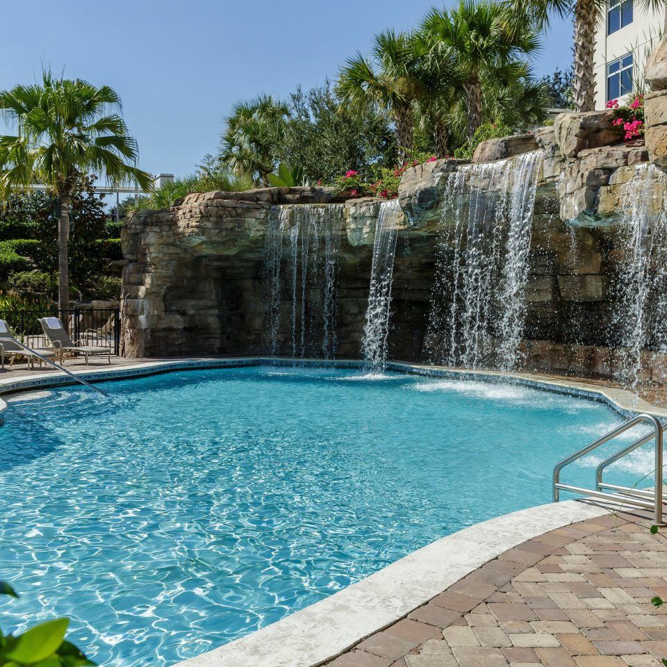 All-inclusive Lounge Play Pool Waterfall tree sky swimming pool property reflecting pool Villa backyard Resort water feature stone swimming