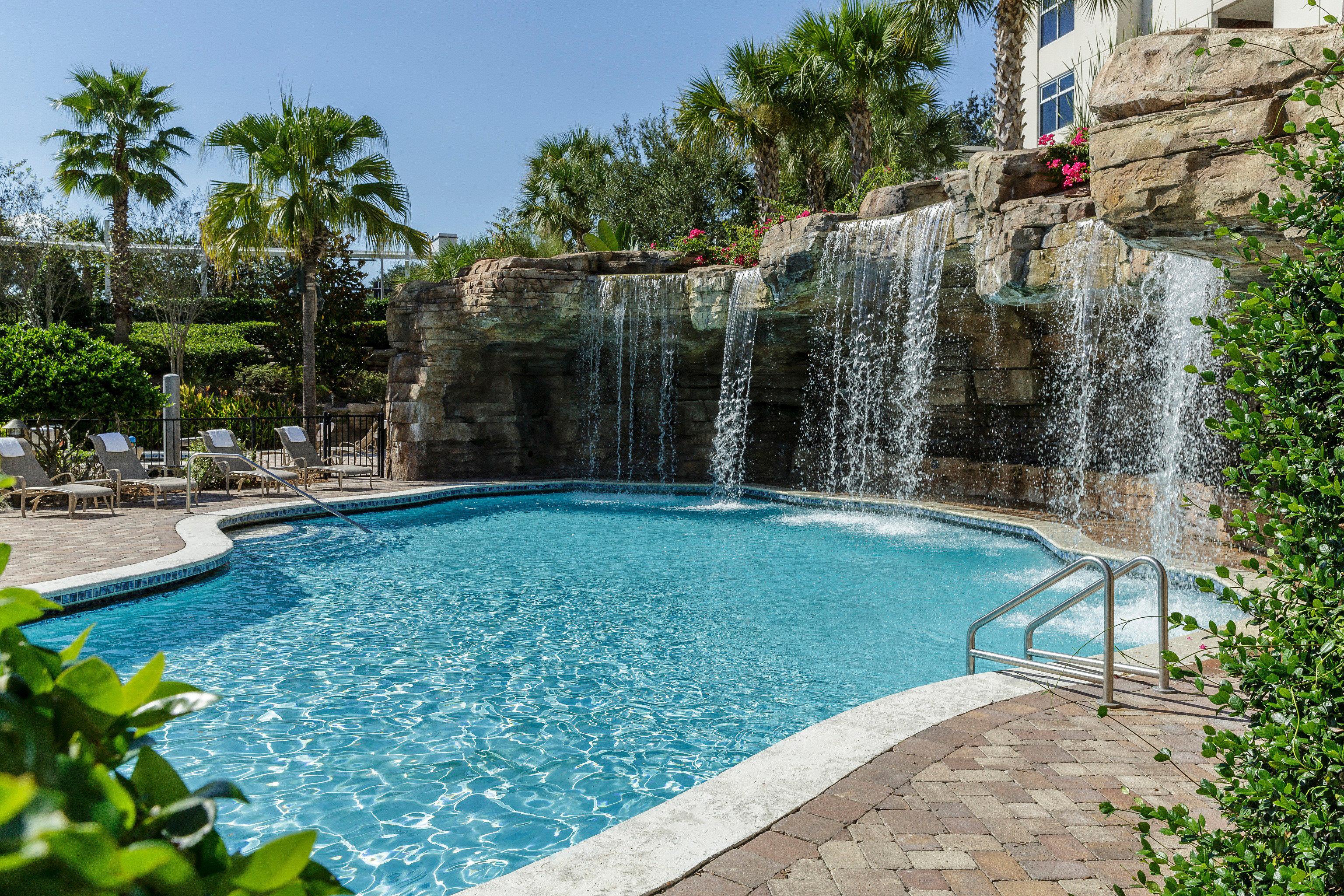 All-inclusive Lounge Play Pool Waterfall tree sky swimming pool property reflecting pool Villa backyard Resort water feature stone swimming