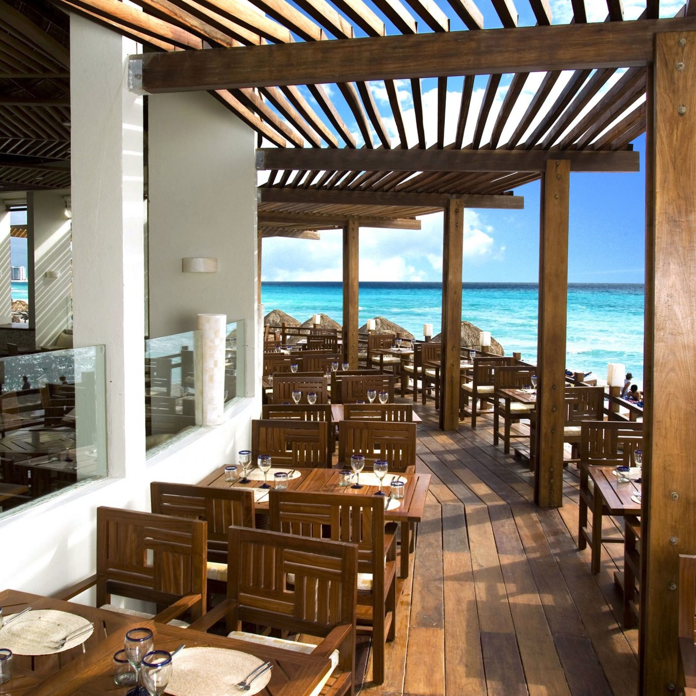 All-inclusive All-Inclusive Resorts Beachfront Deck Drink Eat Hotels Luxury Solo Travel chair property restaurant Resort Lobby overlooking