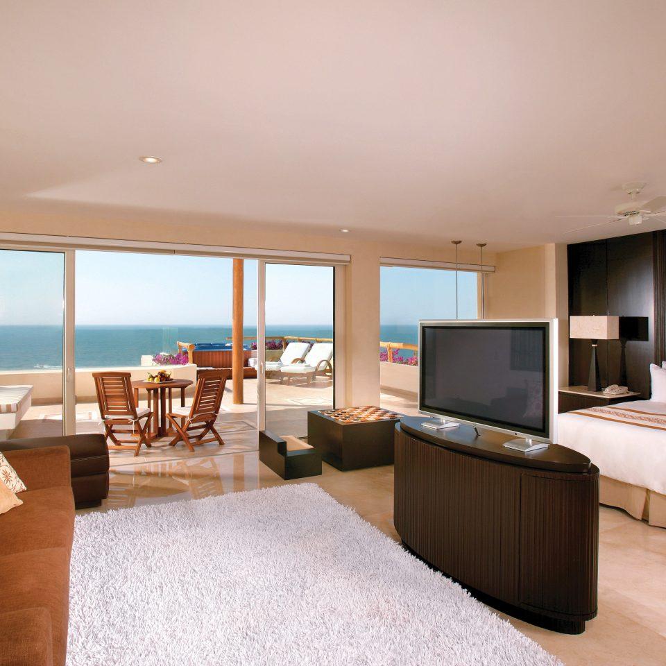 All-Inclusive Resorts Balcony Beachfront Bedroom Hotels Romance Scenic views sofa property Suite Villa living room cottage condominium flat