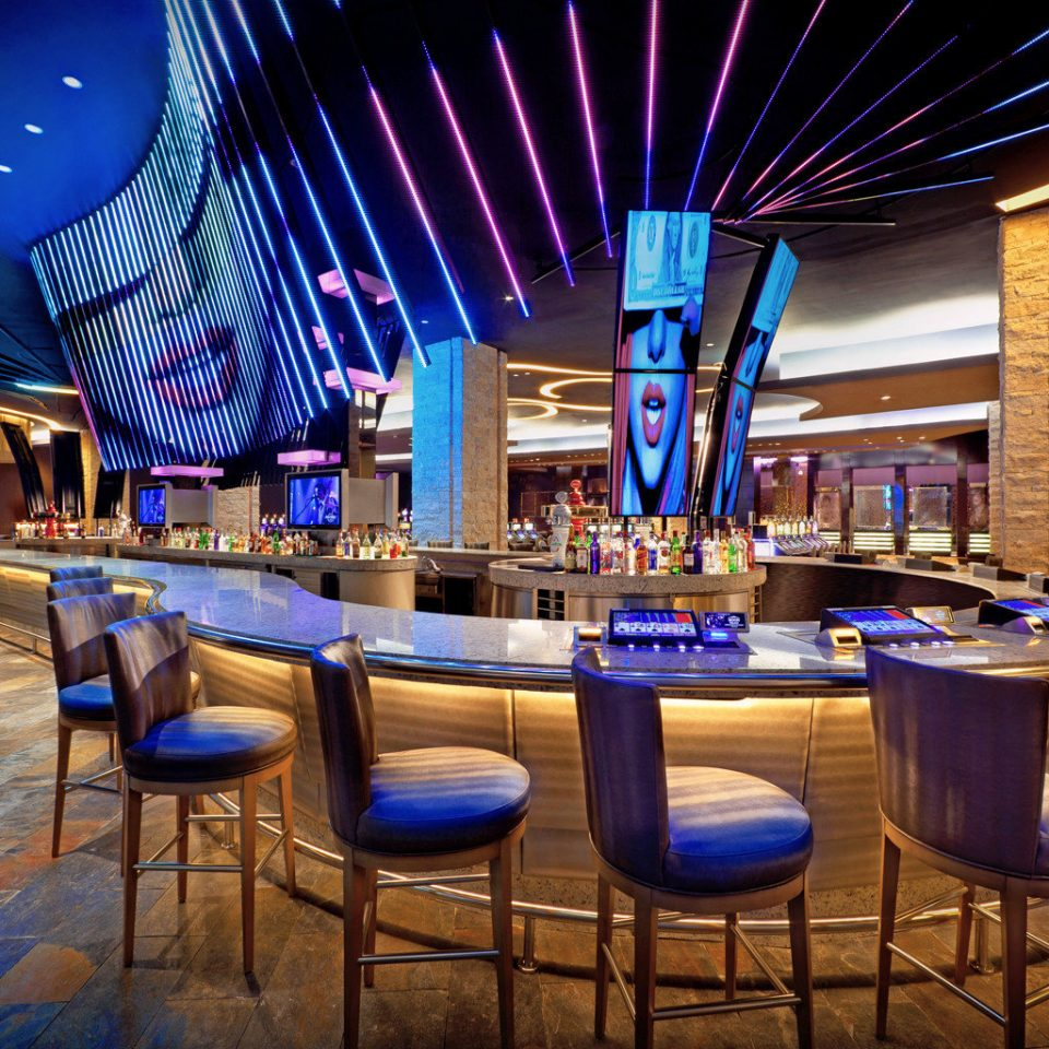 All-Inclusive Resorts Bar Dining Drink Eat Elegant Hip Hotels Modern Solo Travel chair function hall convention center blue nightclub ballroom restaurant Lobby