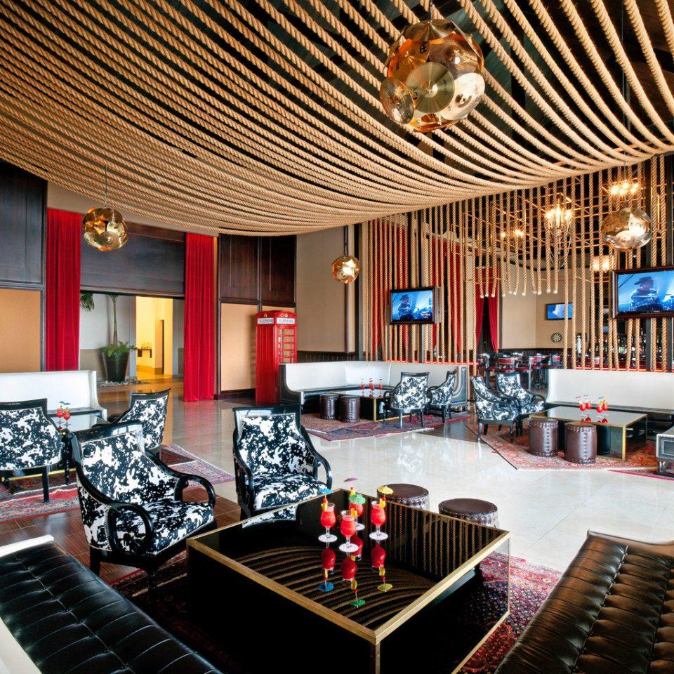 All-Inclusive Resorts Bar Dining Drink Eat Elegant Hip Hotels Modern Solo Travel recreation room Lobby Resort billiard room restaurant living room