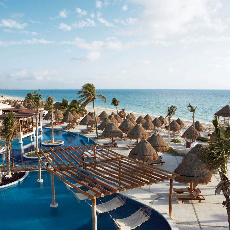 All-Inclusive Resorts Beachfront Elegant Hotels Lounge Luxury Modern Pool Romance water sky Boat leisure Sea Beach caribbean Resort marina Ocean dock Lagoon Coast swimming pool shore lined