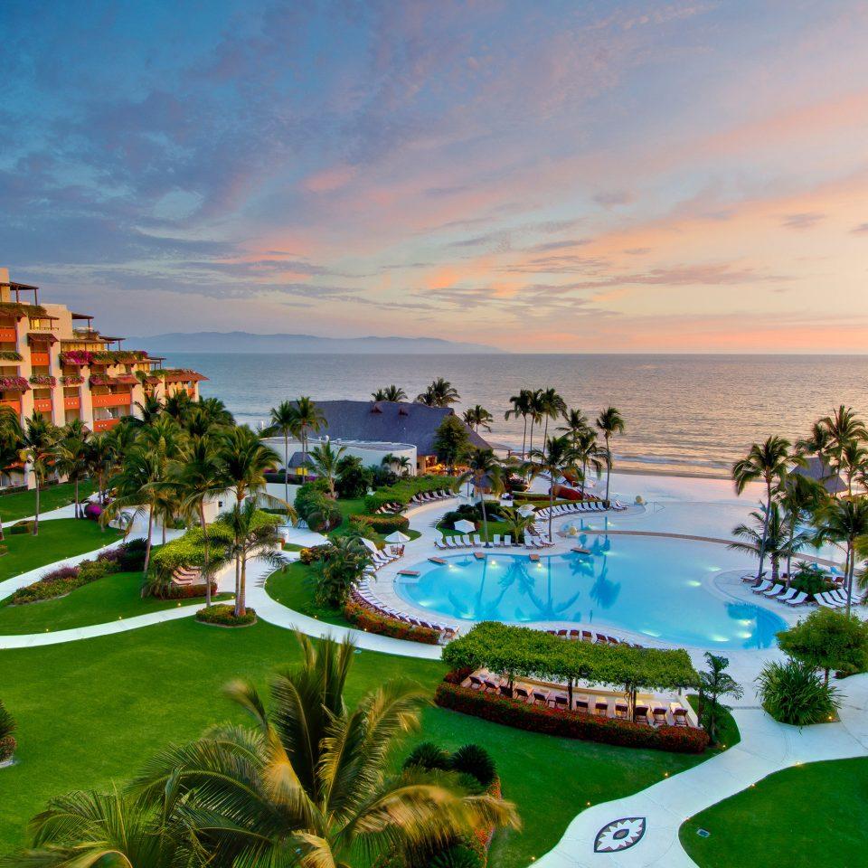 All-Inclusive Resorts Beach Beachfront Exterior Grounds Hotels Pool Resort Romance Sunset Tropical sky grass green Sea Coast swimming pool caribbean plant Garden