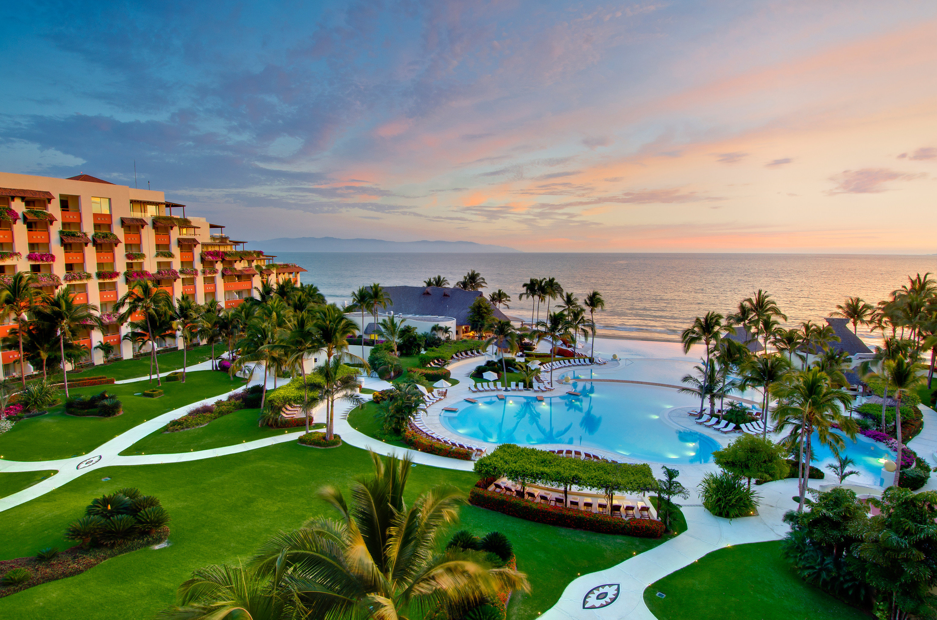 All-Inclusive Resorts Beach Beachfront Exterior Grounds Hotels Pool Resort Romance Sunset Tropical sky grass green Sea Coast swimming pool caribbean plant Garden