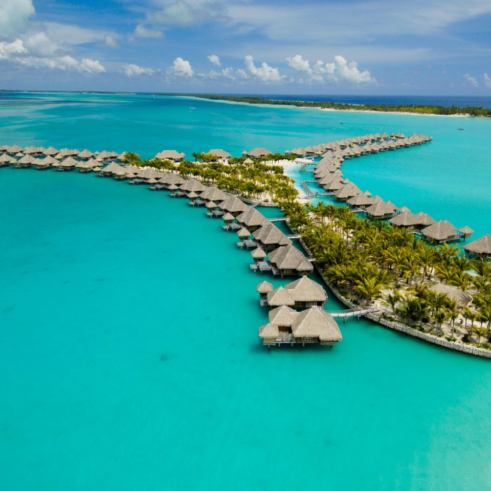All-Inclusive Resorts Beach Boutique Hotels Hotels Island Overwater Bungalow Romance Scenic views Tropical water sky archipelago Boat Ocean Sea caribbean Nature reef Coast islet Lagoon aerial photography atoll cape inlet cay cove blue swimming shore