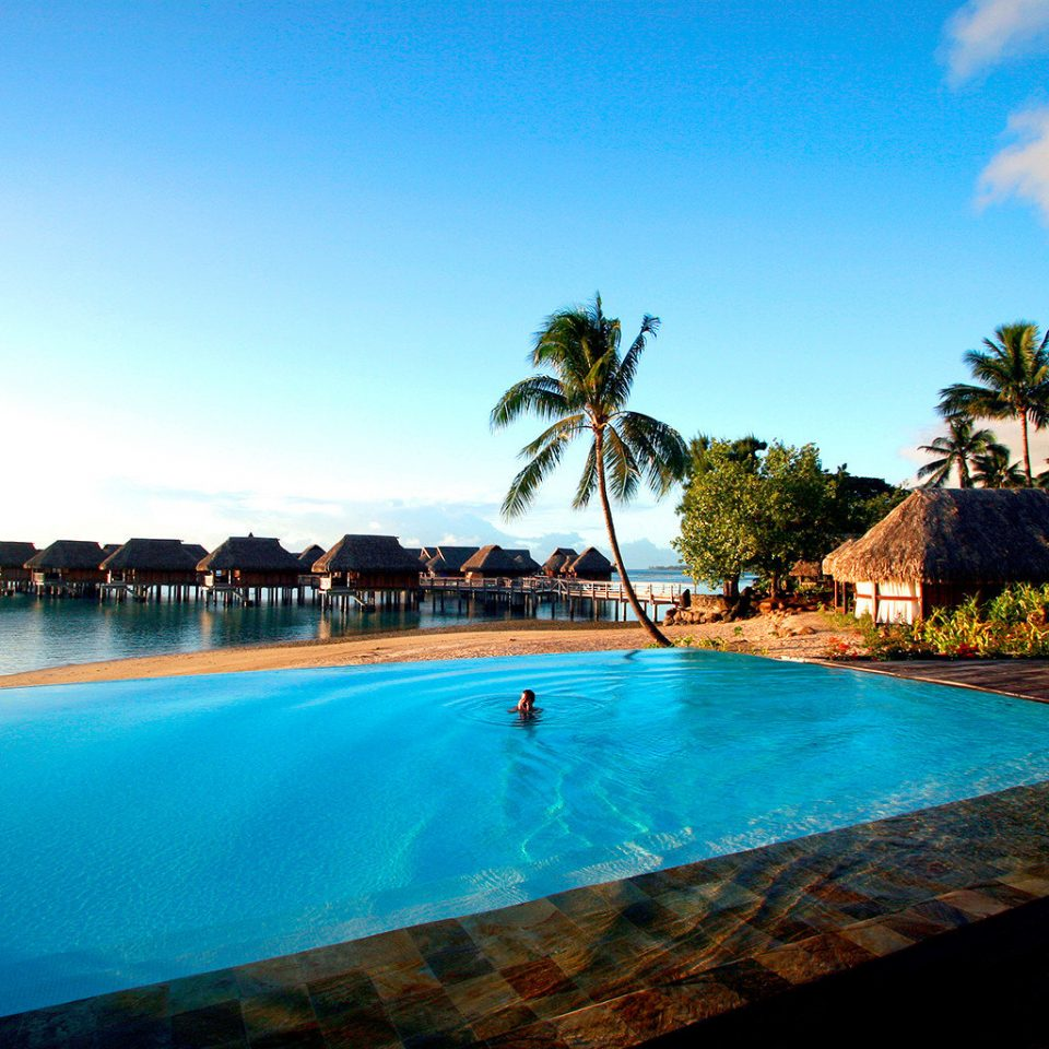 All-Inclusive Resorts Boutique Hotels Hotels Luxury Overwater Bungalow Play Pool Resort Romance Scenic views Trip Ideas sky water Boat swimming pool leisure scene Sea Ocean Beach caribbean Lagoon arecales blue shore swimming Island