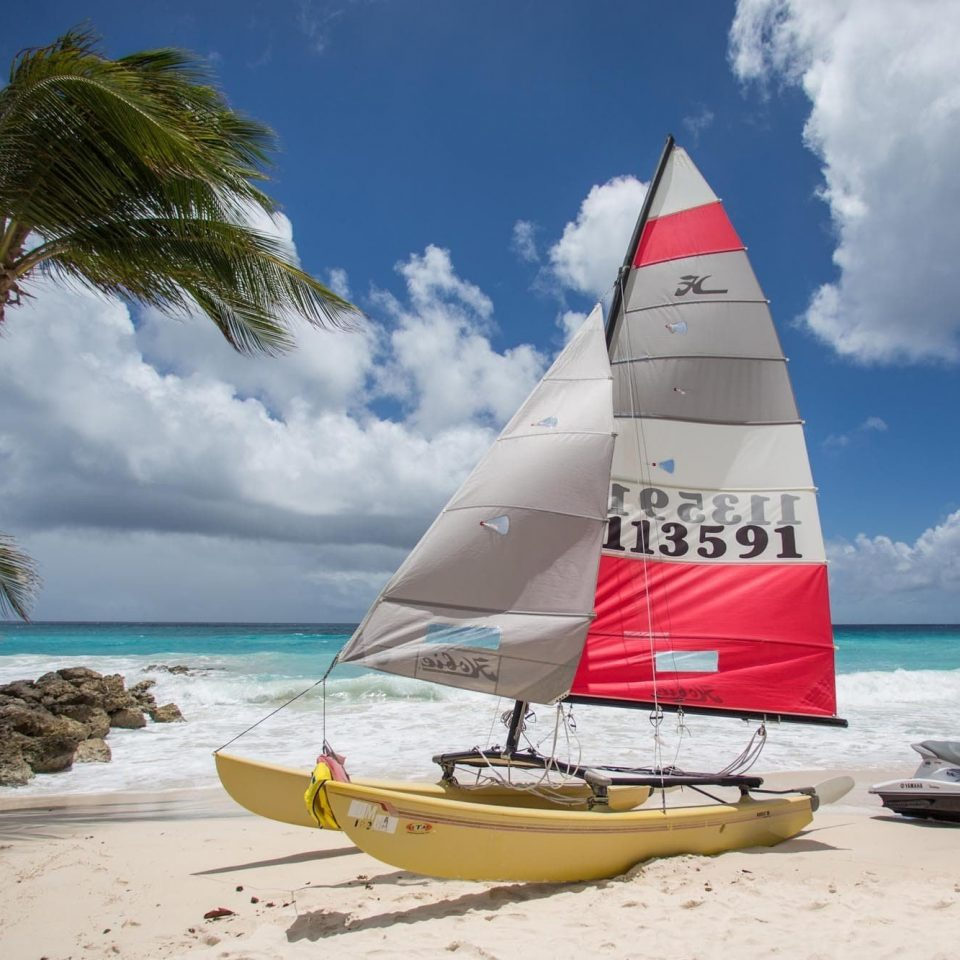 All-Inclusive Resorts Hotels sky watercraft transport water water transportation Boat sailboat coastal and oceanic landforms sail Beach sailing Sea caribbean shore sailing vessel Ocean vehicle leisure Coast dinghy sailing wave tropics tree proa catamaran Island cloud lugger sandy day