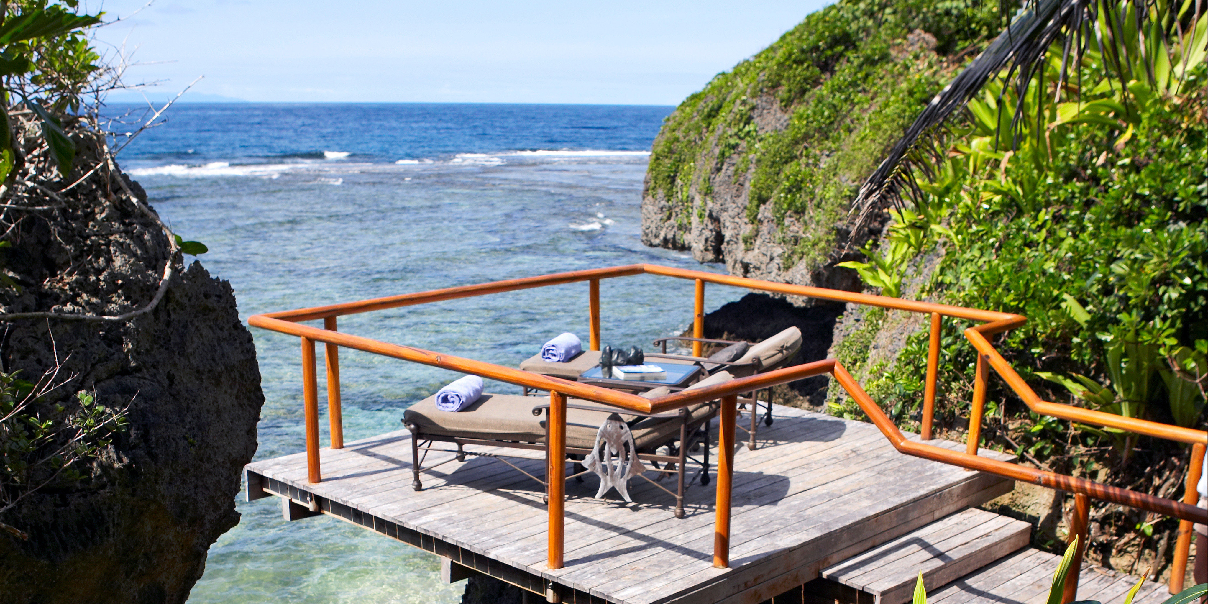 All-Inclusive Resorts Boutique Hotels Deck Hotels Luxury Travel Romance Scenic views Waterfront tree sky water leisure Resort Nature wooden Sea Beach cottage Villa swimming pool caribbean tropics overlooking