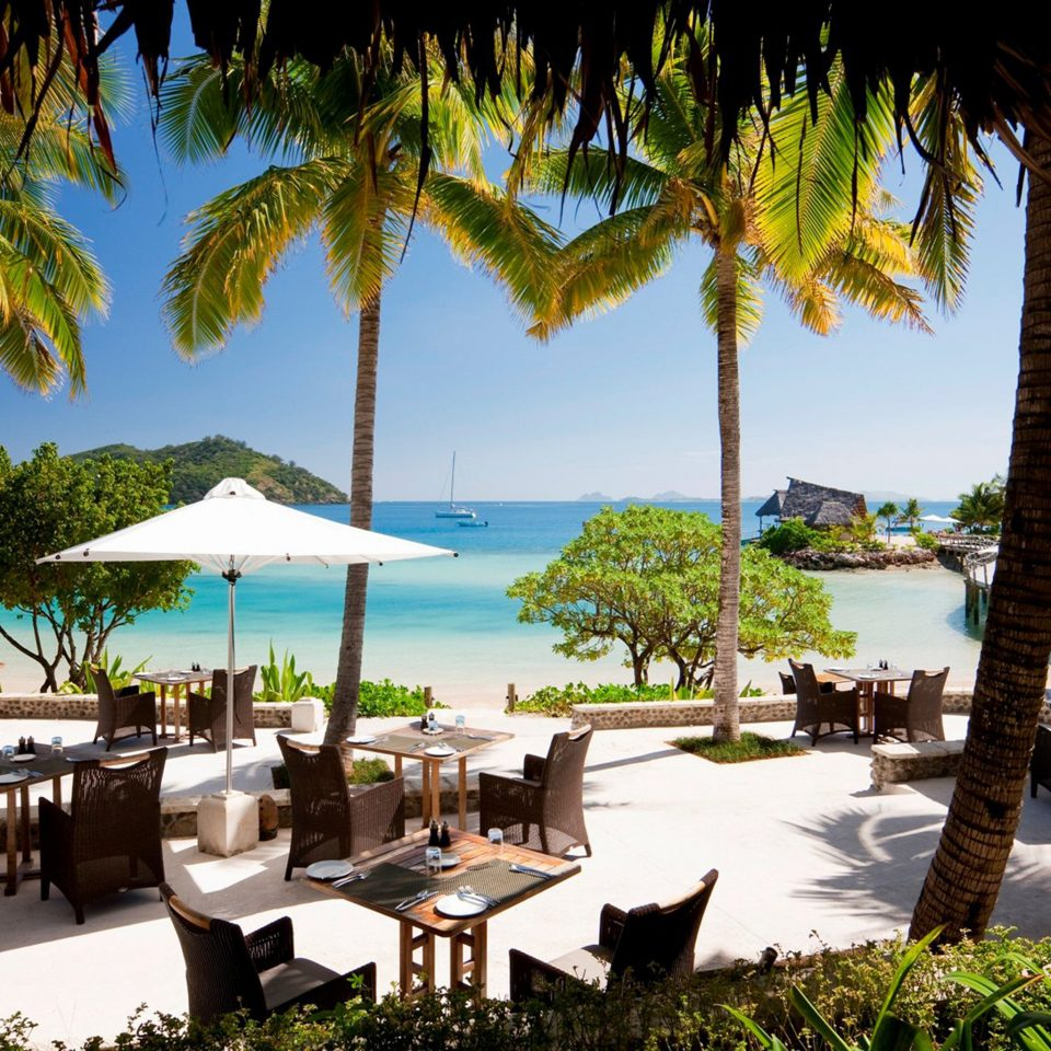 All-Inclusive Resorts Beach Boutique Hotels Dining Drink Eat Hotels Patio Romance Scenic views Terrace tree sky palm water leisure Resort plant arecales caribbean swimming pool palm family tropics Villa lined shore shade