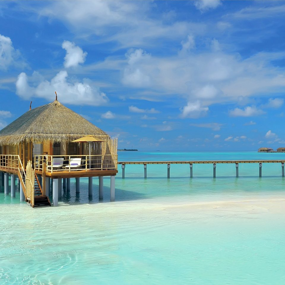 All-Inclusive Resorts Hotels Island Luxury Luxury Travel Overwater Bungalow Romance Romantic Waterfront sky water pier scene Sea Beach Ocean caribbean Resort shore Coast swimming pool Lagoon Pool tropics blue swimming day