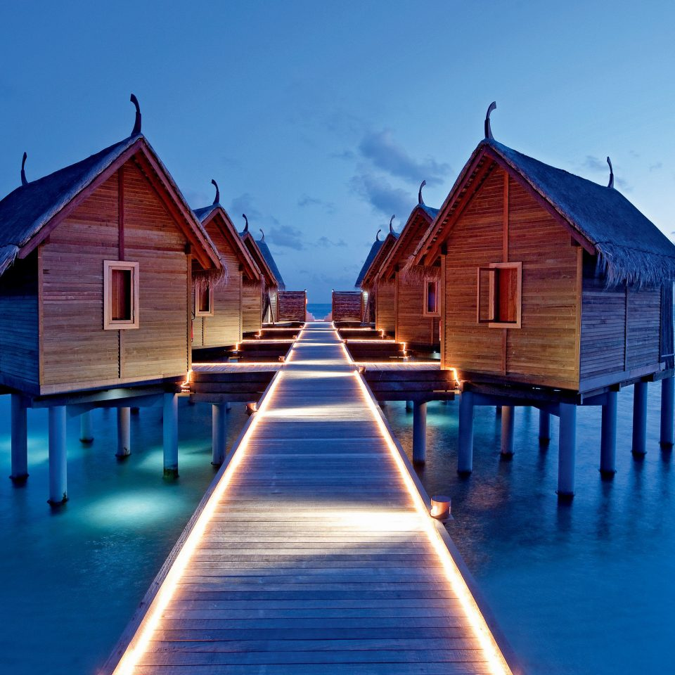 All-Inclusive Resorts Grounds Hotels Island Luxury Overwater Bungalow Romance Romantic Waterfront water house sky wooden blue scene Ocean Sea Beach sunlight Resort