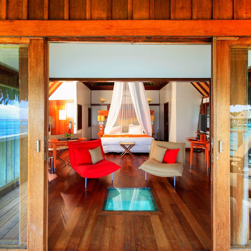 All-Inclusive Resorts Bedroom Boutique Hotels Hotels Luxury Overwater Bungalow Resort Romance Scenic views Trip Ideas property house wooden home living room cottage mansion Villa