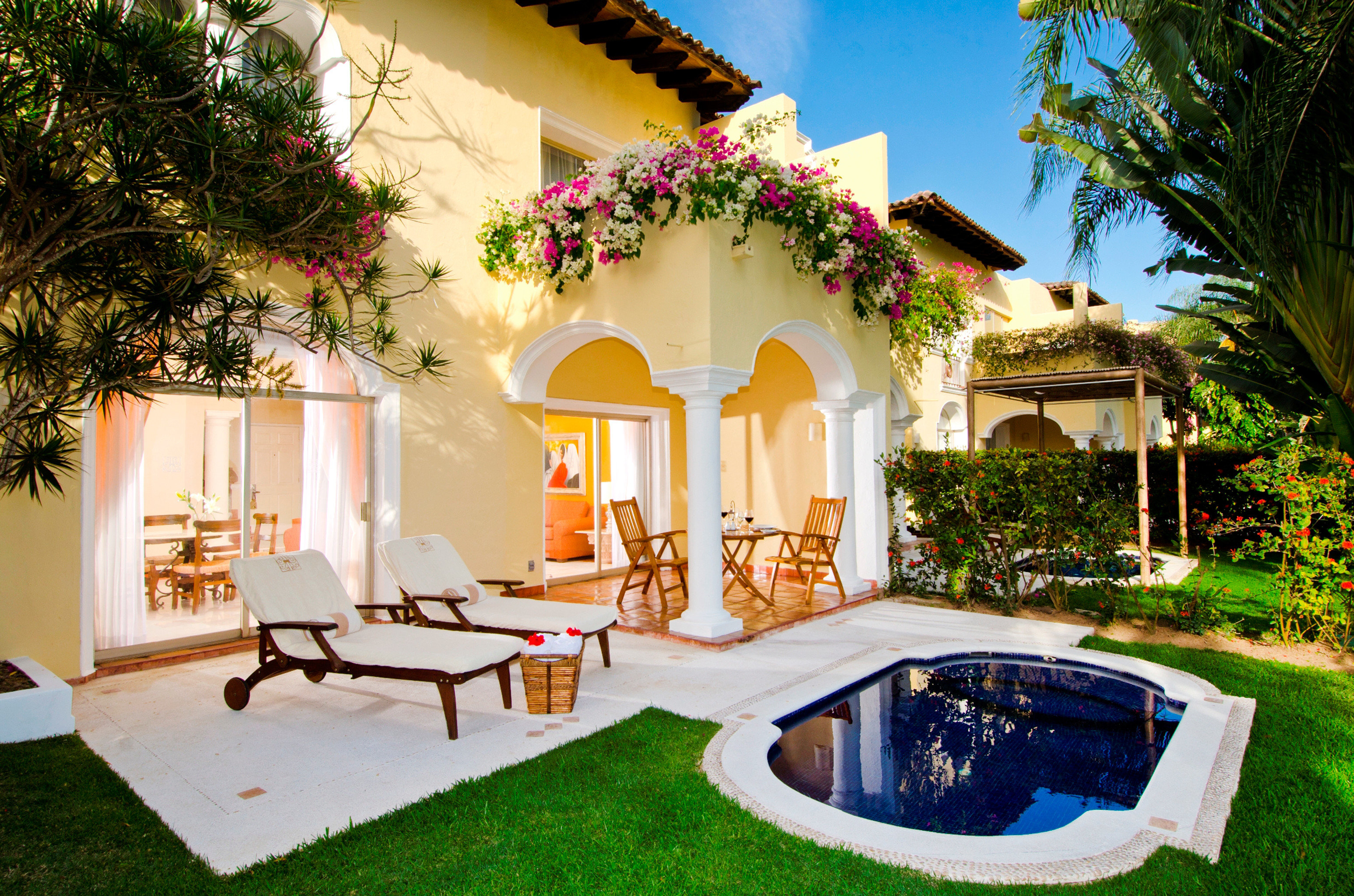 All-Inclusive Resorts Elegant Hotels Lounge Luxury Modern Pool tree grass house property home Villa swimming pool mansion backyard hacienda Resort Courtyard cottage outdoor structure