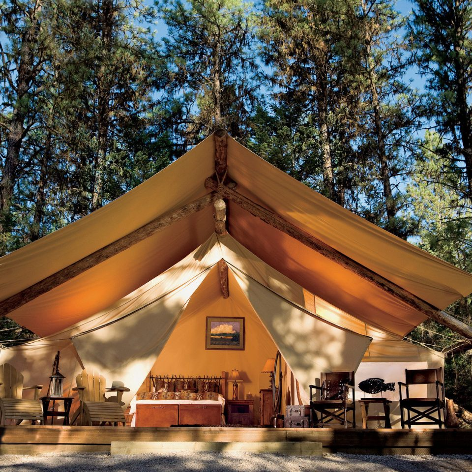 All-Inclusive Resorts Glamping Hotels Luxury Travel Trip Ideas tree temple shinto shrine tent shrine place of worship pavilion outdoor object wooded