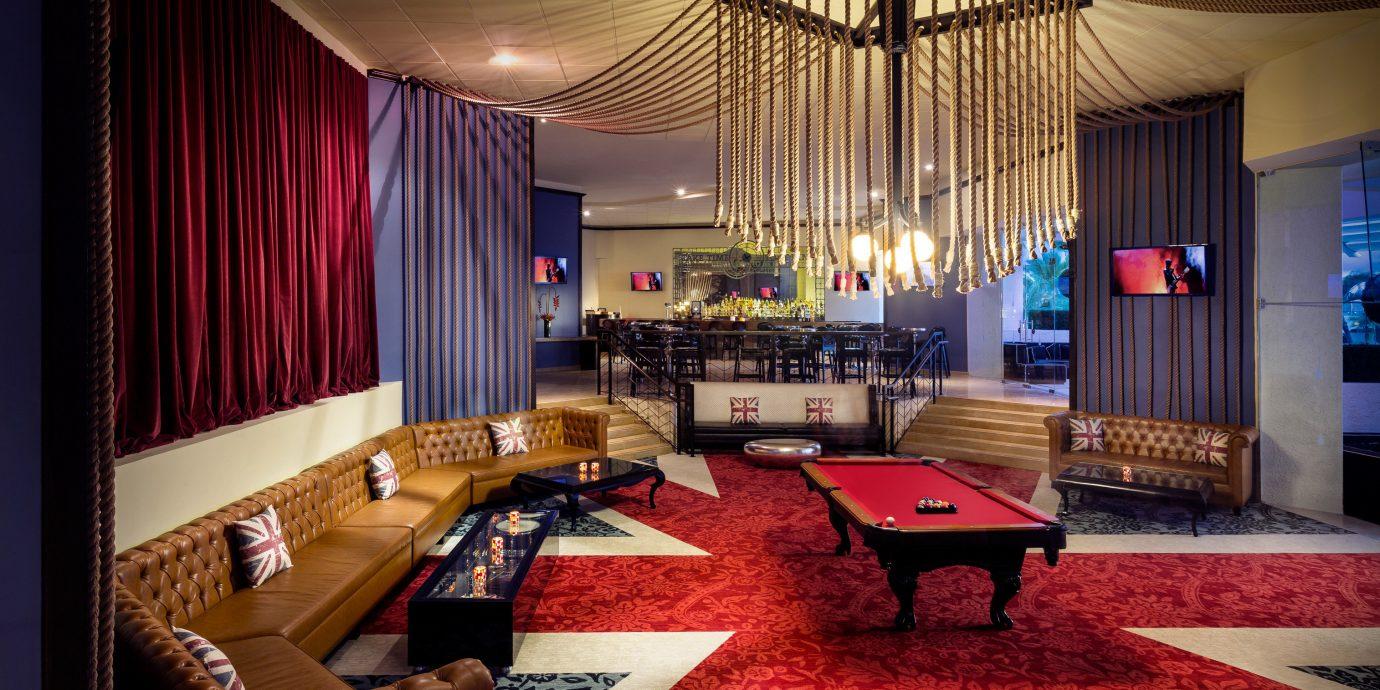 All-Inclusive Resorts Hip Hotels Lounge Modern recreation room billiard room living room Suite home Resort Lobby rug