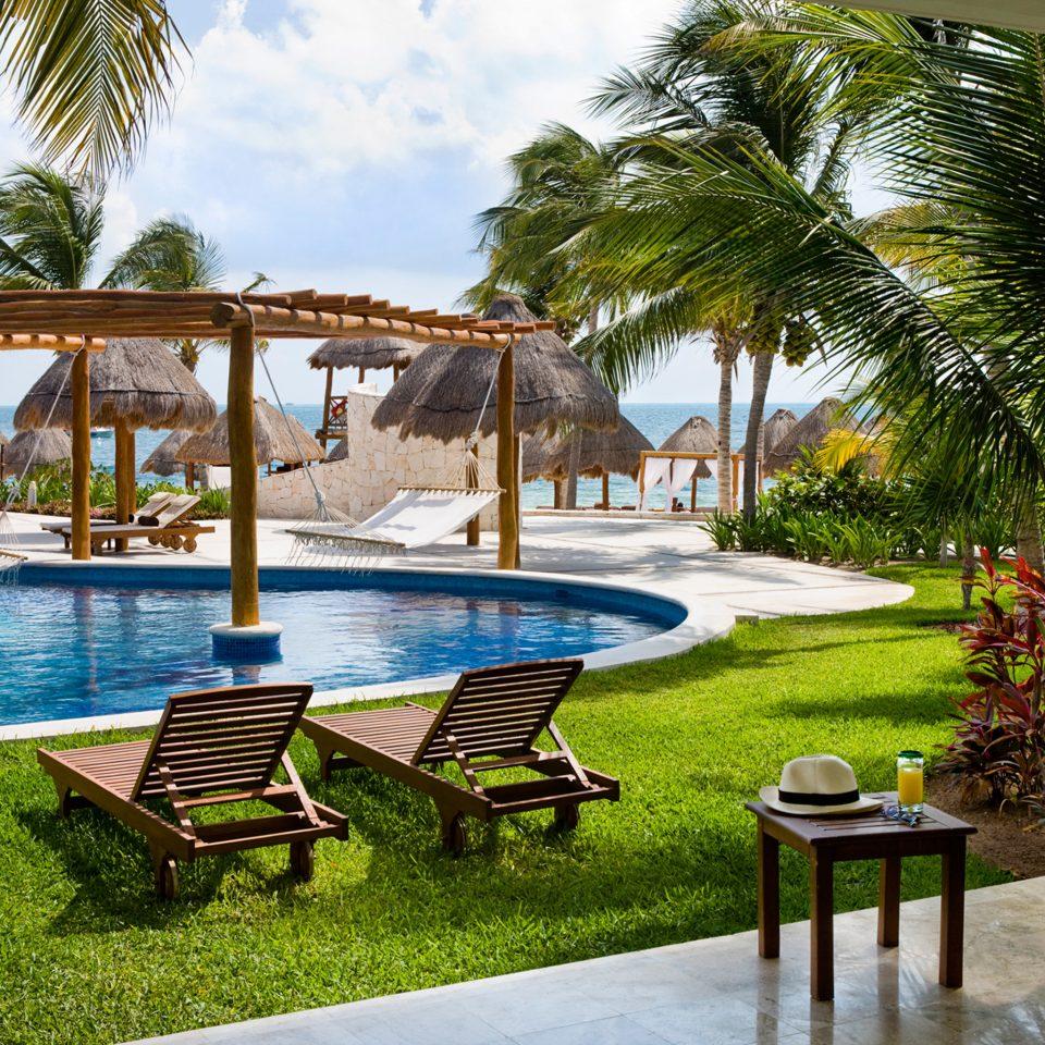 All-Inclusive Resorts Hotels Lounge Luxury Pool Romance Tropical tree grass chair leisure property Resort swimming pool lawn home Villa backyard hacienda caribbean plant palm