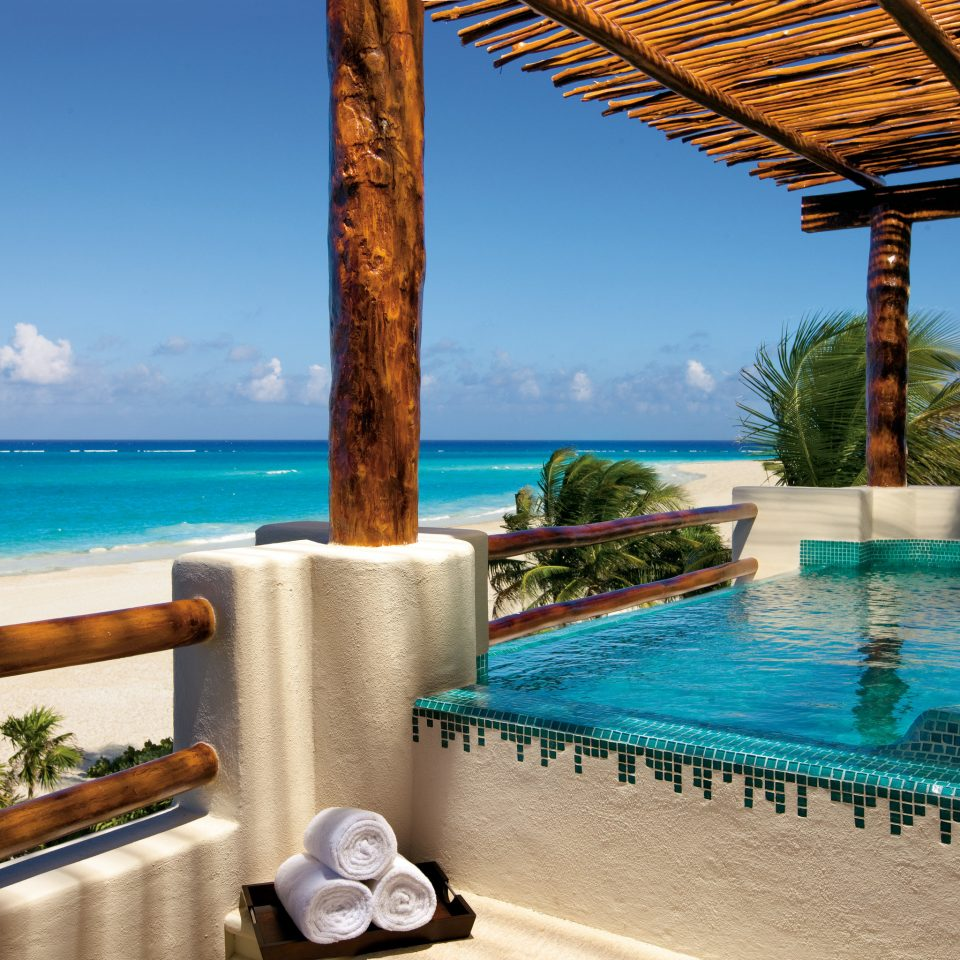 All-Inclusive Resorts Hotels Romance sky water Resort property swimming pool leisure Sea caribbean Villa palm tree tropics resort town arecales Ocean hacienda amenity overlooking
