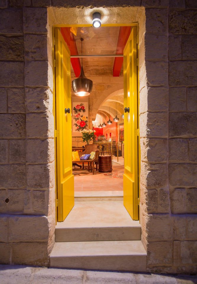 building color yellow red road street alley open temple door shrine restaurant opened