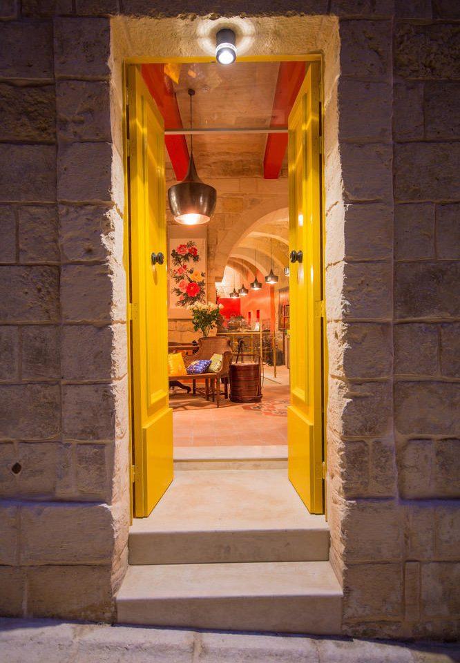 building color yellow red road street alley open temple door shrine restaurant opened