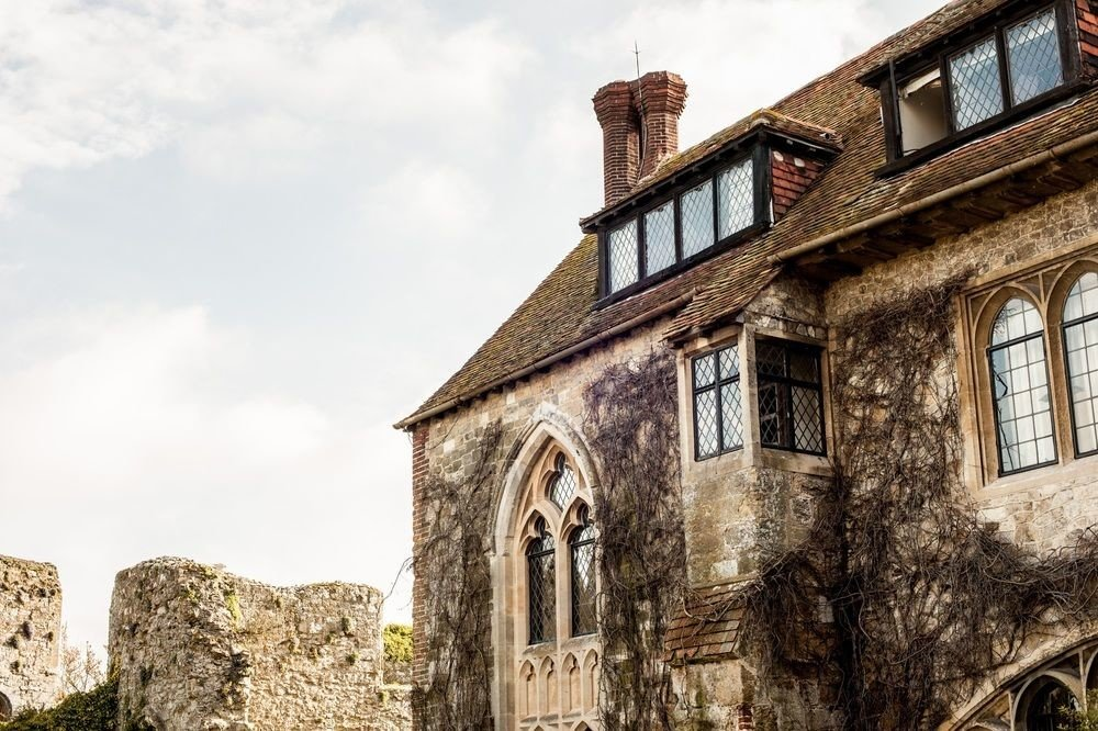 building sky stone old property brick rock house home cottage medieval architecture mansion tree roof manor house almshouse stately home history tall