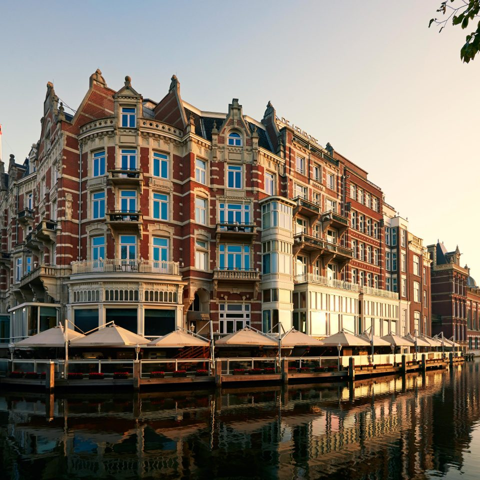 Amsterdam Architecture Buildings City Elegant Historic Hotels Lake The Netherlands Waterfront water sky Boat scene landmark waterway River vehicle Harbor Canal cityscape