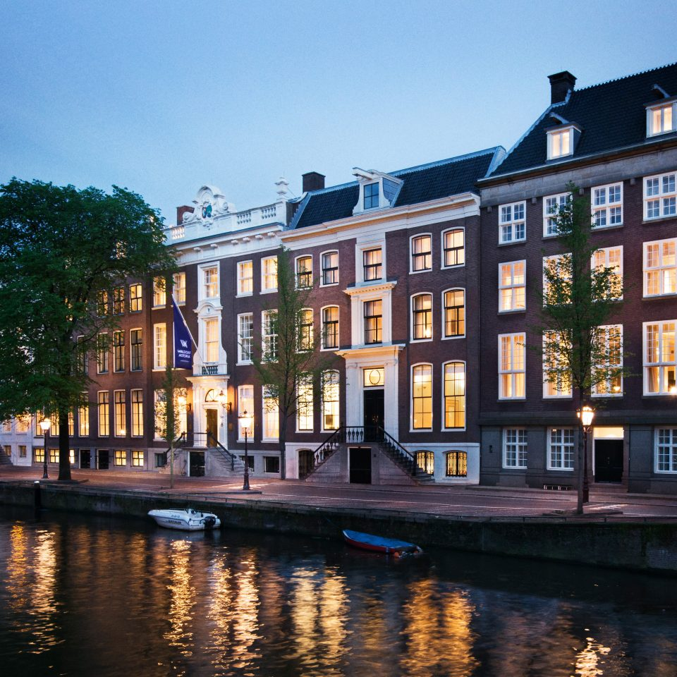 Amsterdam Architecture Buildings City Elegant Exterior Family Hotels Luxury Romantic The Netherlands Waterfront sky building water Canal waterway Town landmark house evening cityscape
