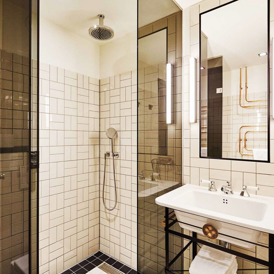 Amsterdam Boutique Hotels Hotels The Netherlands bathroom property sink plumbing fixture flooring tile tiled tan