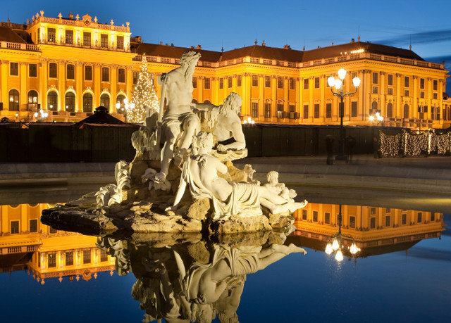 sky building landmark night yellow ancient rome palace plaza ancient history evening water feature statue town square monument fountain colonnade