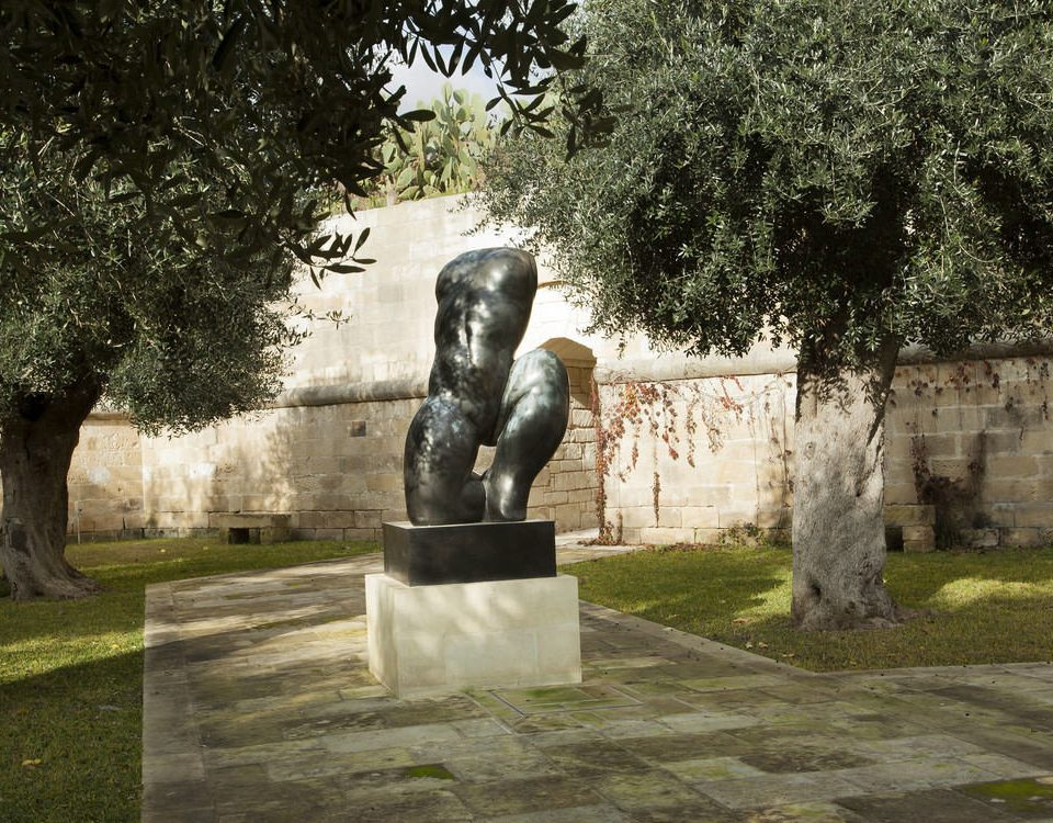 tree grass sculpture statue monument building art park memorial cemetery ancient history stone
